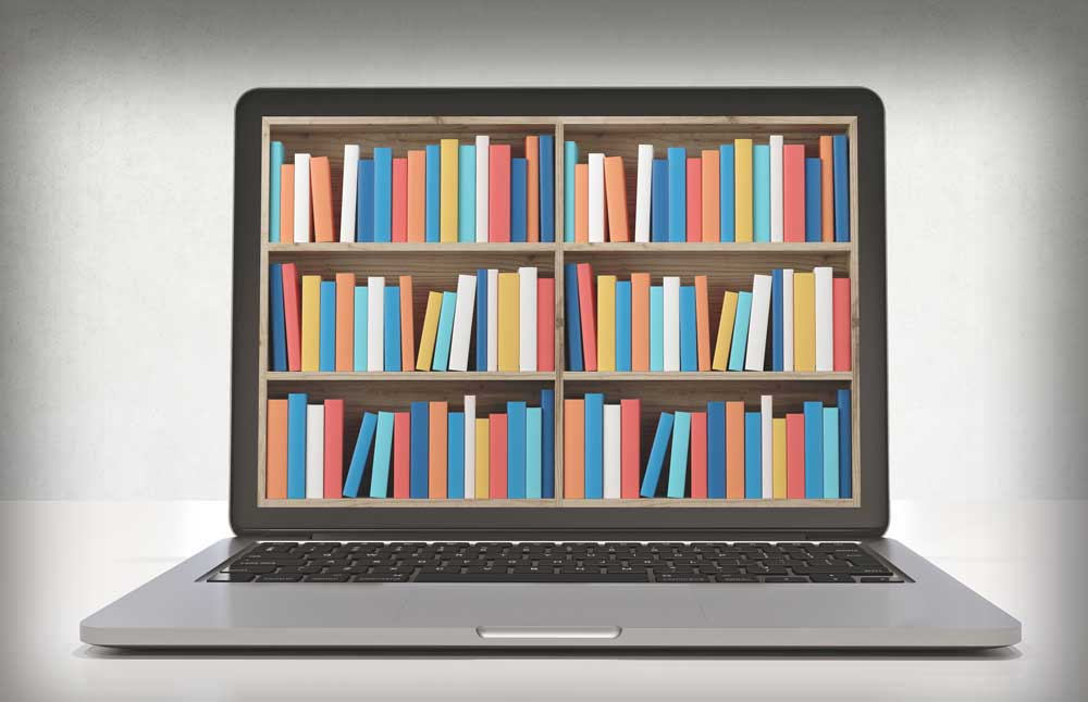 Colorful books inside a computer screen